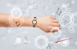 Hand with watch and numbers on the side comming out Royalty Free Stock Photo