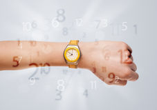 Hand with watch and numbers on the side Royalty Free Stock Images