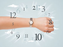 Hand with watch and numbers on the side comming out Royalty Free Stock Image