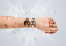 Hand with watch and numbers on the side comming out Stock Photography