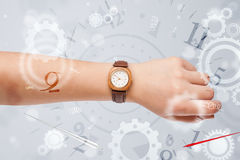Hand with watch and numbers on the side comming out Stock Photo
