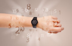 Hand with watch and numbers on the side comming out Stock Images