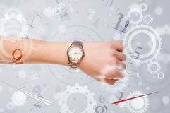 Hand with watch and numbers on the side comming out Royalty Free Stock Photography
