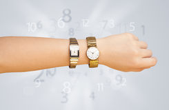 Hand with watch and numbers on the side comming out Stock Image