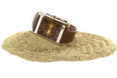 A hand watch on the sand Stock Images