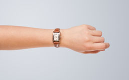 Hand with watch showing precise time Stock Images