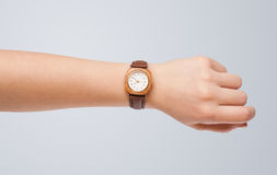 Hand with watch showing precise time. Hand with modern watch showing precise time Royalty Free Stock Images