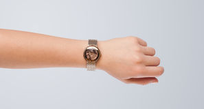 Hand with watch showing precise time Stock Photography