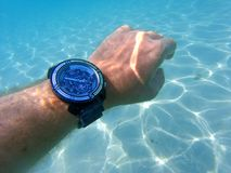 Hand with watch under the sea Royalty Free Stock Photography