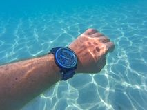 Hand with watch under the sea Stock Image