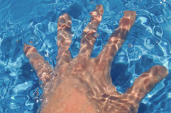 Hand in water Stock Images