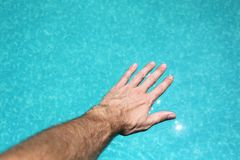 Hand on water Stock Image