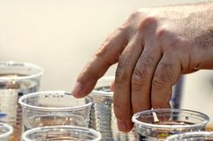 Hand on water cup. A view of a hand grasping a cup of water.  Taken at the running of the Berlin marathon Royalty Free Stock Photography