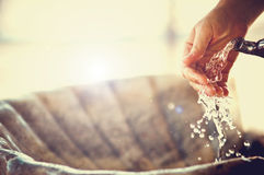 Hand and water Stock Photos