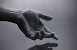 Hand with water drop Stock Photos