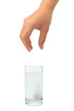 Hand and water glass with pill Royalty Free Stock Photography