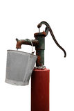 Hand water pump with metal bucket Royalty Free Stock Image