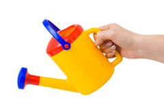 Hand with watering can Royalty Free Stock Image