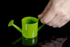 Hand with watering can Stock Photo