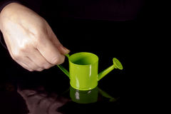 Hand with watering can Royalty Free Stock Photography