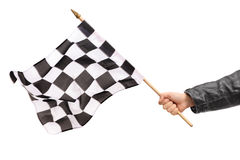 Hand waving a checkered race flag Stock Photos
