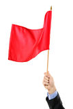 Hand waving a red flag Royalty Free Stock Photo