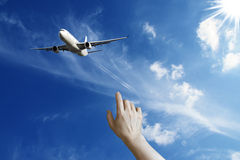 Hand waving to airplane Stock Images