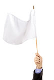 Hand waving a white flag. Isolated on white background Stock Image