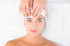 Hand waxing beautiful womans eyebrow Royalty Free Stock Images