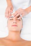 Hand waxing beautiful womans eyebrow Stock Photos