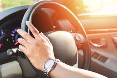 Hand wear a watch and drive a car stock image