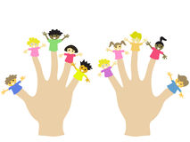 Hand wearing 10 finger children puppets. Hands wearing 10 finger puppets for fun Royalty Free Stock Photo