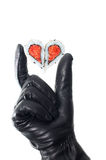Hand wearing black leather glove holding heart Stock Photography