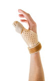 Hand Wearing Brace Over Thumb in White Studio Royalty Free Stock Images