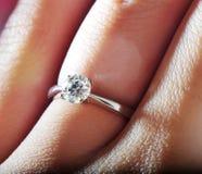Hand wearing diamond ring. Woman's hand wearing diamond ring Stock Images