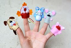 5 finger puppets: dog, cock, cat, mouse, pig Stock Photos