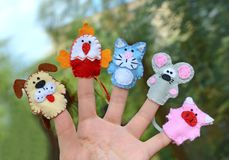 5 finger puppets: dog, cock, cat, mouse, pig Royalty Free Stock Images