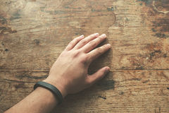 Hand wearing fitness tracker band Stock Photo