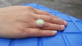 Hand wearing gemstone. Hand wearing silver ring with gemstone Royalty Free Stock Photography