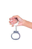 Hand wearing handcuffs Royalty Free Stock Photos