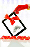 Hand wearing red gloves holding tablet PC Royalty Free Stock Image