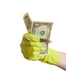 Hand wearing rubber glove holding dollars Stock Photo