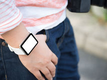 Hand wearing smartwatch with blank screen stock image