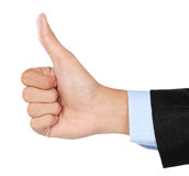 Hand wearing a suit giving the thumbs up sign Royalty Free Stock Photography