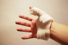 Hand wearing wrist splint. Male hand wearing a wrist splint for a sprained wrist Royalty Free Stock Photography