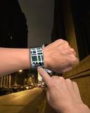 Hand wearing wrist watch with GPS Royalty Free Stock Image