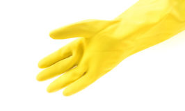 Hand wearing yellow rubber gloves for cleaning on white backgrou. Nd, workhouse concept Stock Image