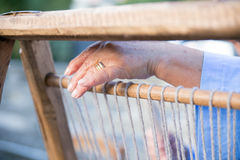 The hand of a weaver using a loom in Lunigiana Royalty Free Stock Photography