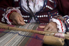 Hand weaving. Close up of weaving textiles using manual loom Stock Photo