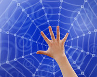 "Hand in web. Teenager's hand touching web, made be ""At"" sign, path included Royalty Free Stock Photography"